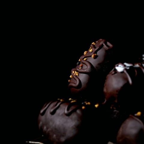 Mini dark chocolate candy bars on a rack.