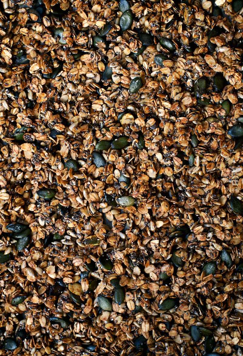 Olive oil granola with pumpkin seeds and oats, in pan.