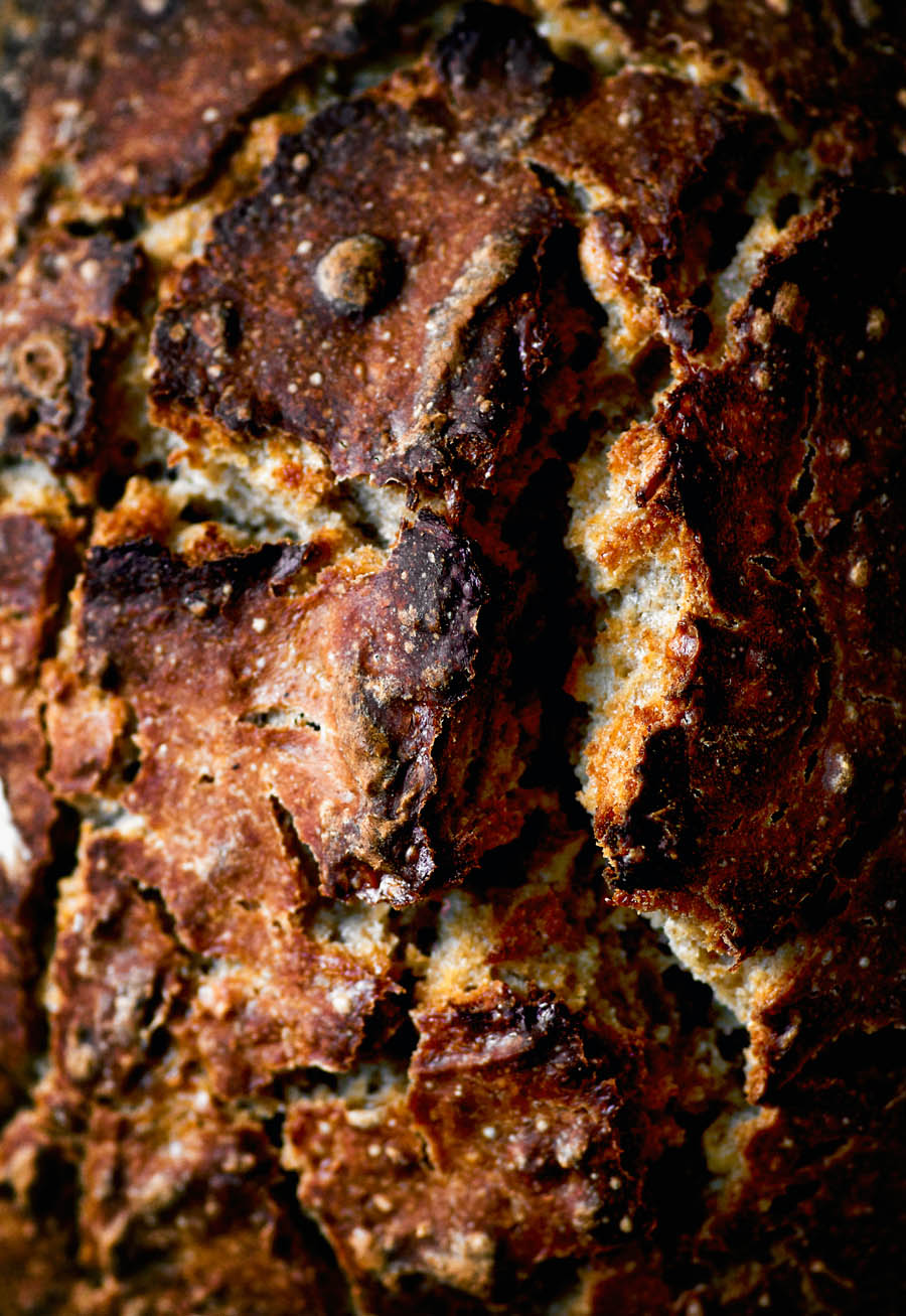 Close up of the top crust of a loaf of bread.
