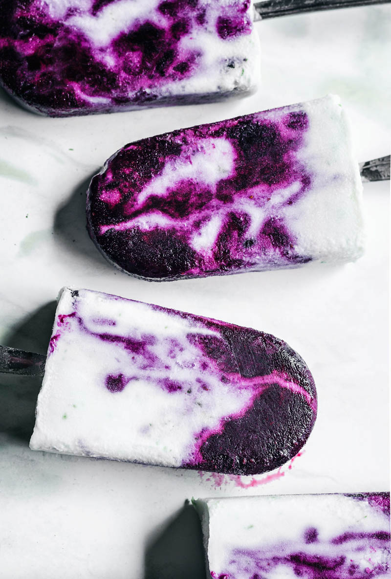 Blueberry jam swirled popsicles, close up.