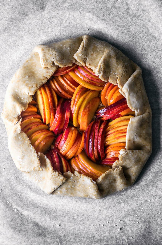 Unbaked summer fruit galette.