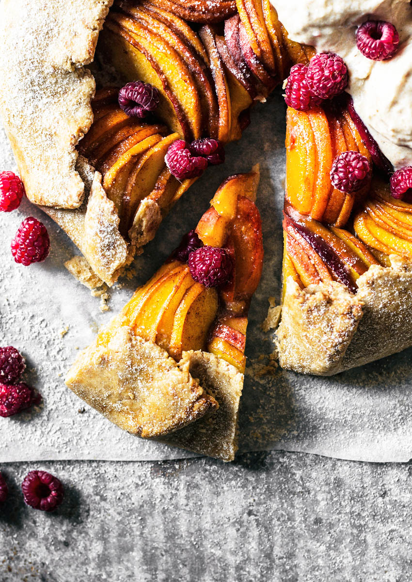 Stone fruit galette with on slice cut, close up.