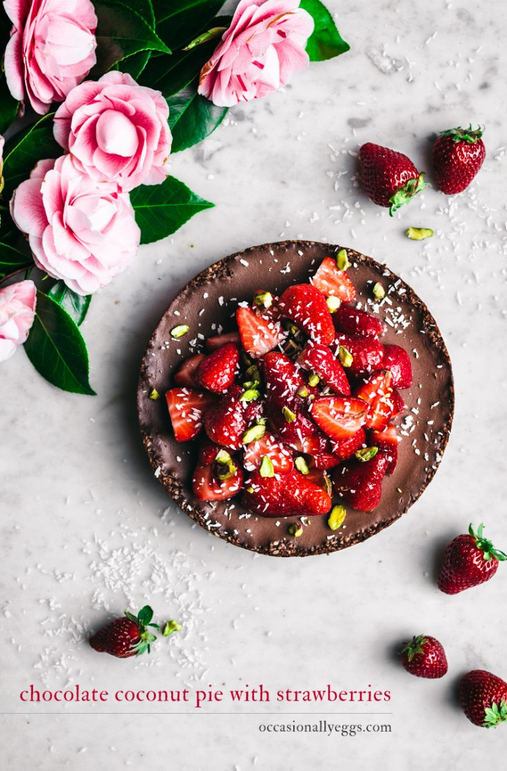 Chocolate Coconut Pie with Strawberries   occasionallyeggs.com - this gluten & sugar free chocolate pie is made with a date coconut macaroon base and chocolate ganache filling, topped with sweet fresh strawberries. #glutenfree #grainfree #paleo #dates #coconut #veganrecipes #pegan