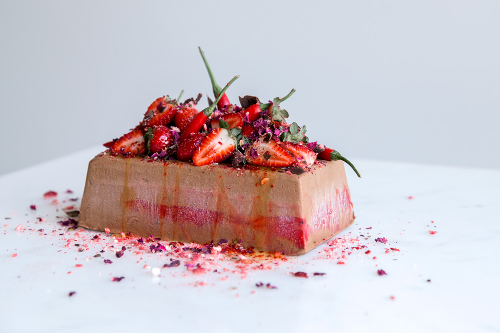 Chocolate semifreddo topped with strawberries and chili peppers.