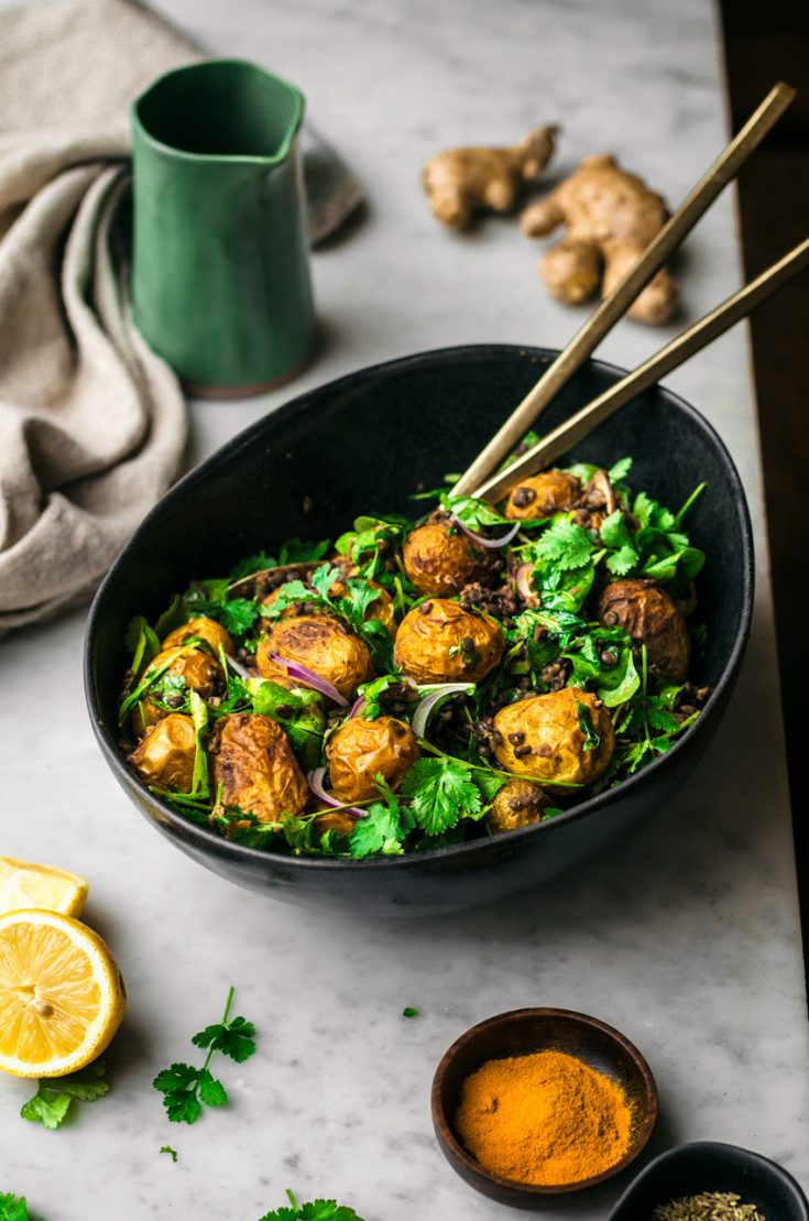 Curried Potato Salad | occasionallyeggs.com - a vegan roasted potato salad with curry, beluga lentils, greens, and a lemon ginger dressing. #potatoes #potatosalad #curry #lentils #summer #spring #vegan #healthy