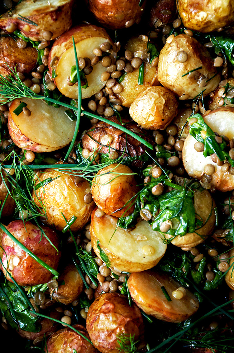 Close up of roasted potato salad with lentils and greens.