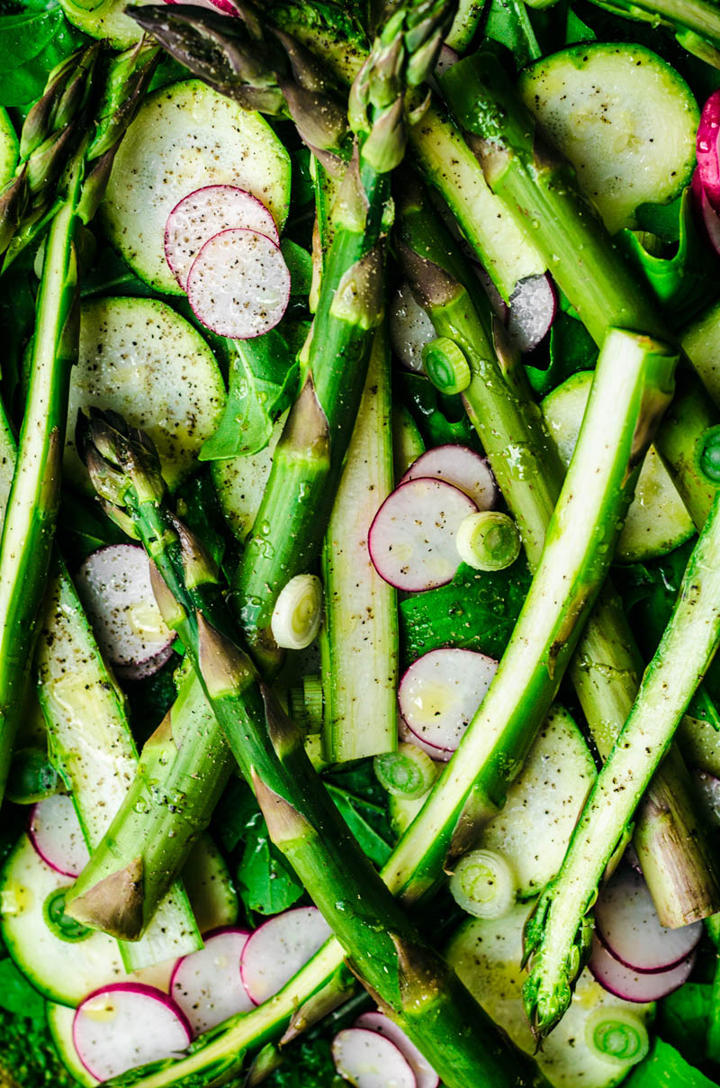 Close up of vegetables topping pizza before baking.