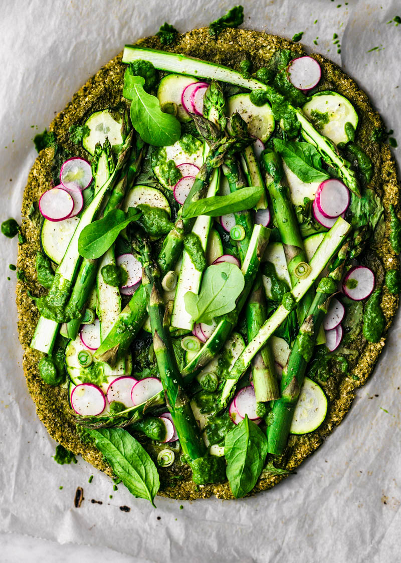 Broccoli crust pizza with asparagus, radishes, and greens.