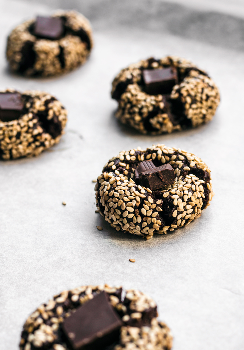 Chocolate thumbprint cookies with sesame seeds and chocolate centre.