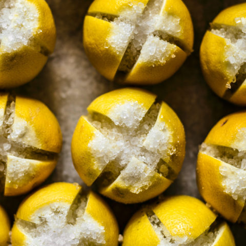Preserved lemons stuffed with coarse salt.