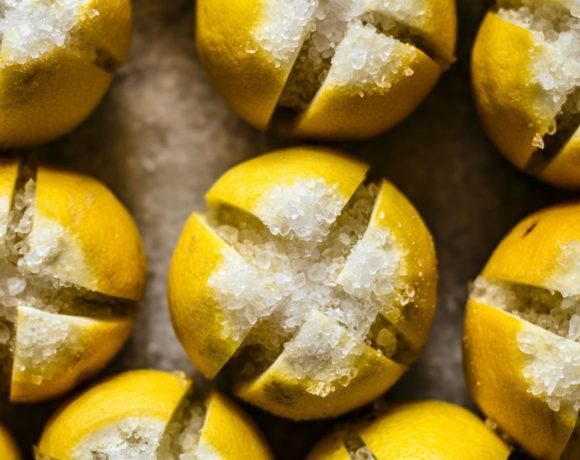 Preserved lemons stuffed with coarse salt.