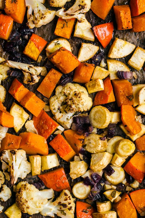 Roasted parsnips, pumpkin, and cauliflower on a baking sheet.