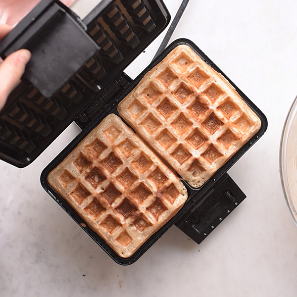 Baked waffles in the waffle iron.
