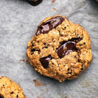 Multigrain chocolate chunk cookies on parchment paper, close up.