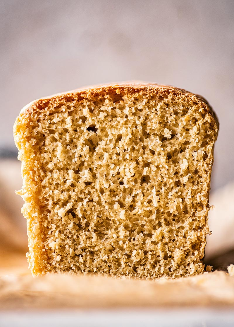 Close up of bread loaf showing the crumb and texture.