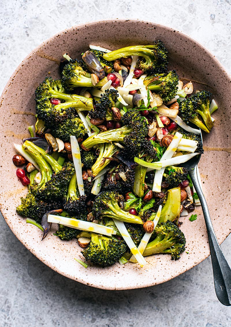 Top down view of vegan broccoli salad with fruit and nuts.