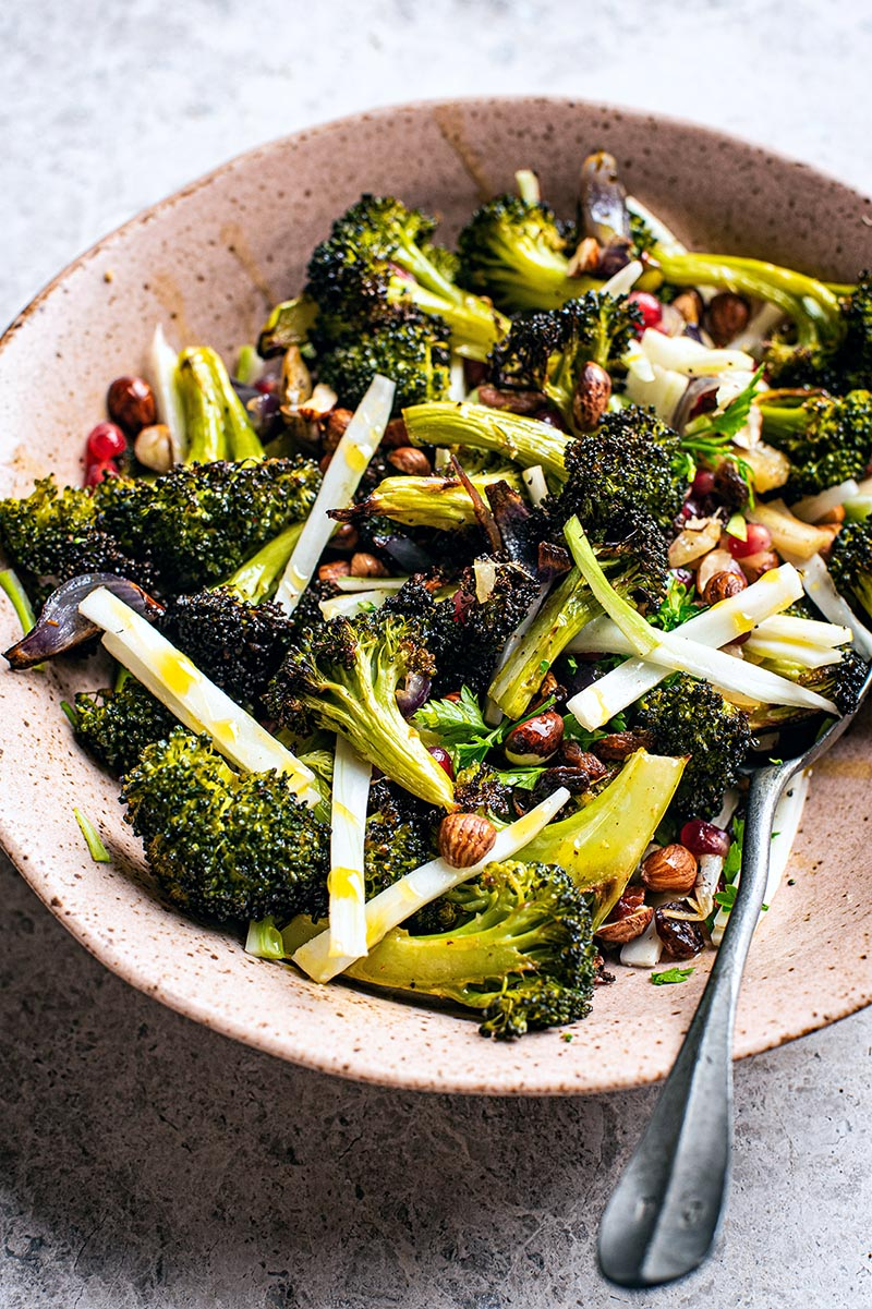 Front/top view of broccoli salad, with roasted florets and julienned stems.
