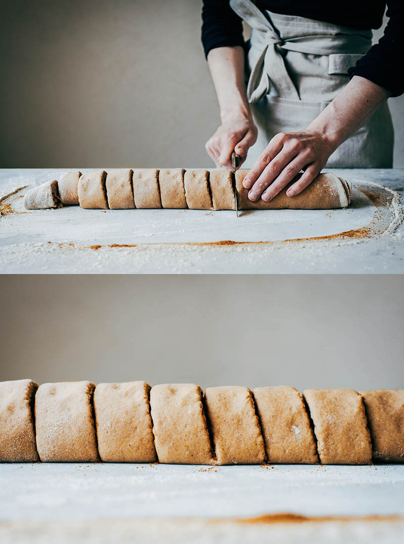 Top image: woman cutting rolled up cinnamon roll dough. Bottom, close up of cut dough to show size.