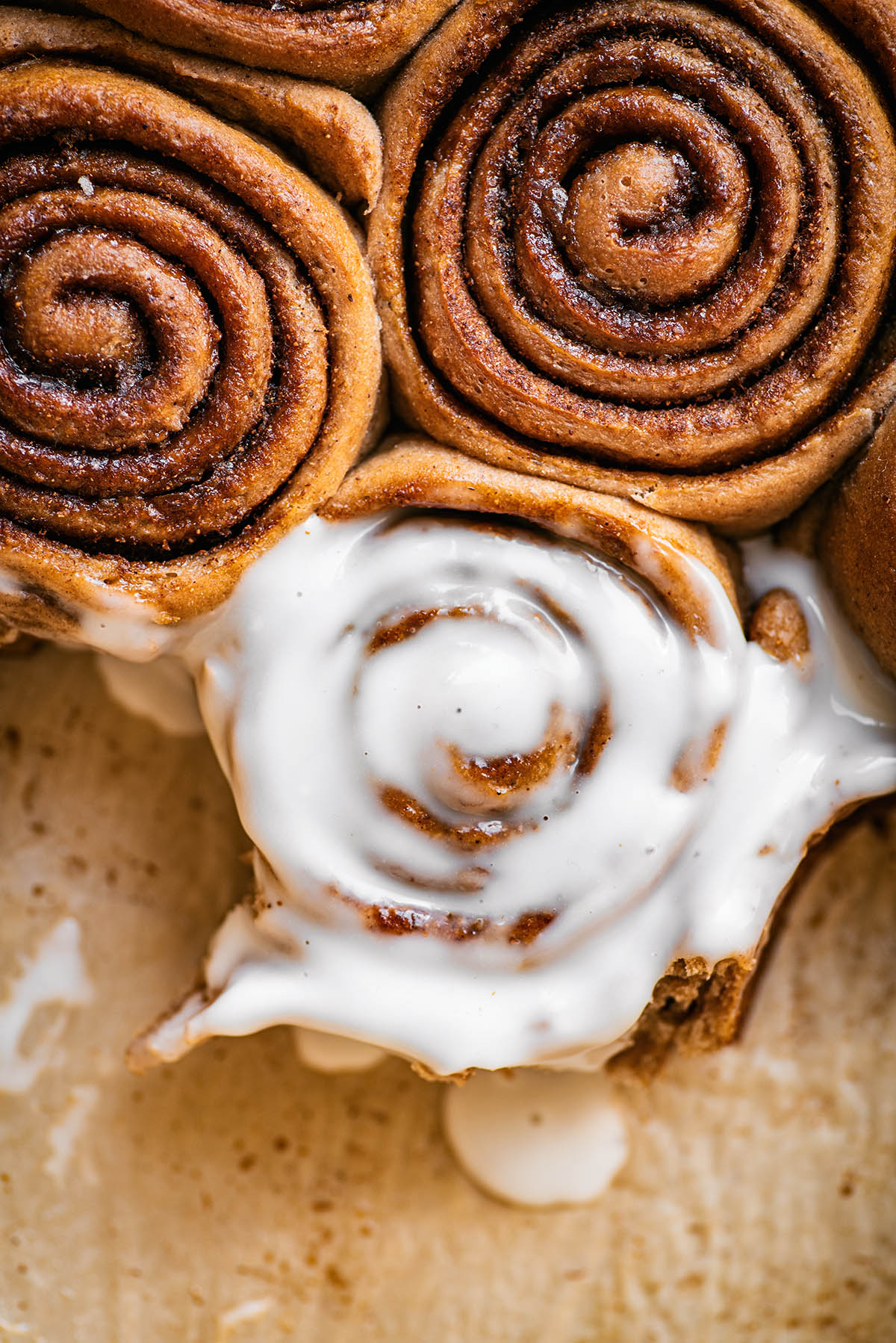 Cinnamon rolls, close up, one with icing.