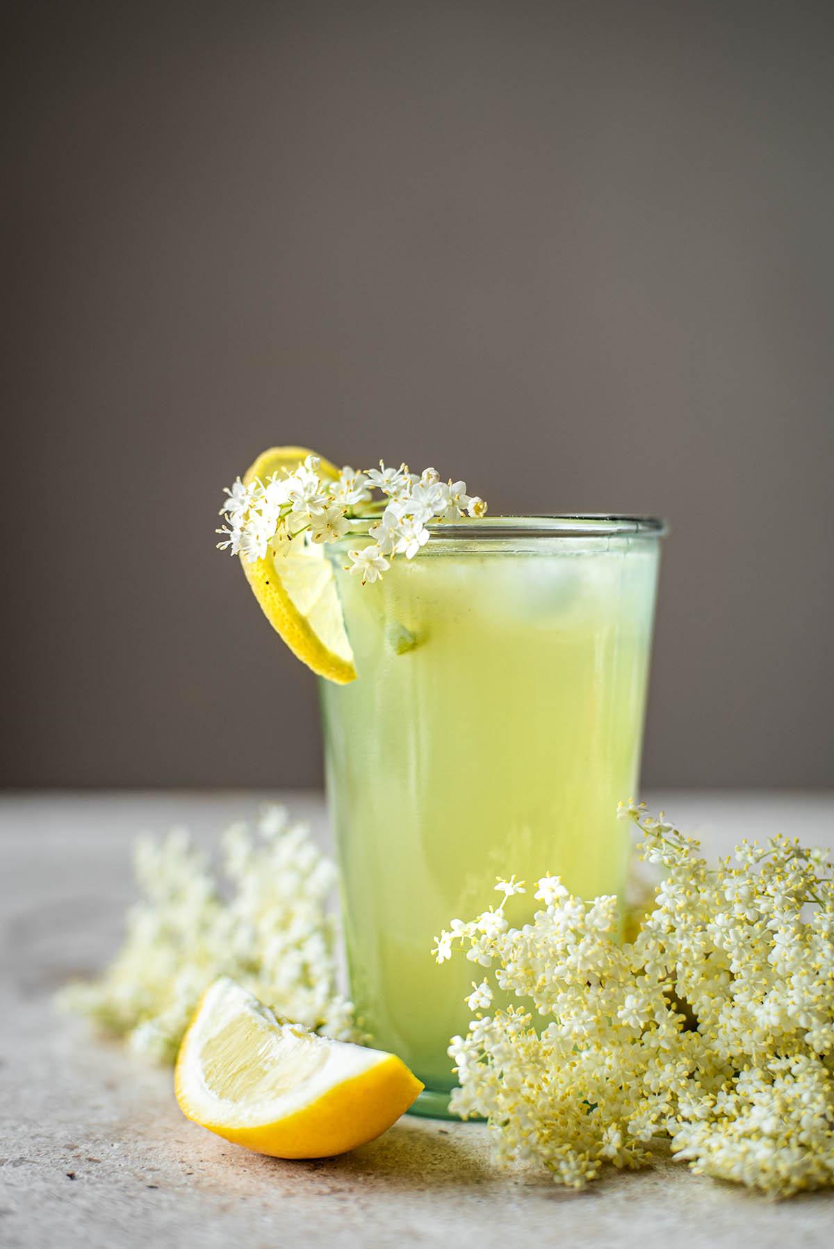 A glass of lemonade with elderflower.