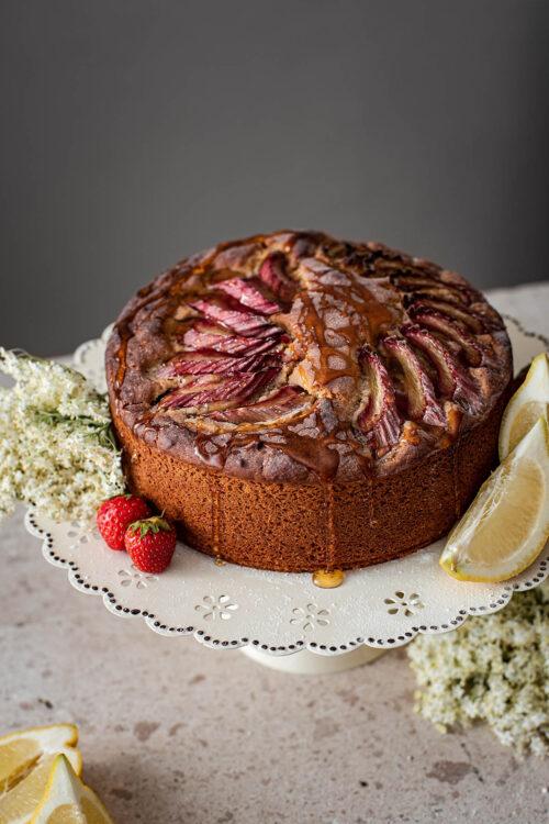 Rhubarb lemon cake on a cake stand.