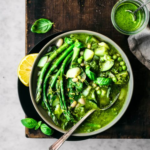 Spring minestrone with asparagus in a bowl with a spoon.