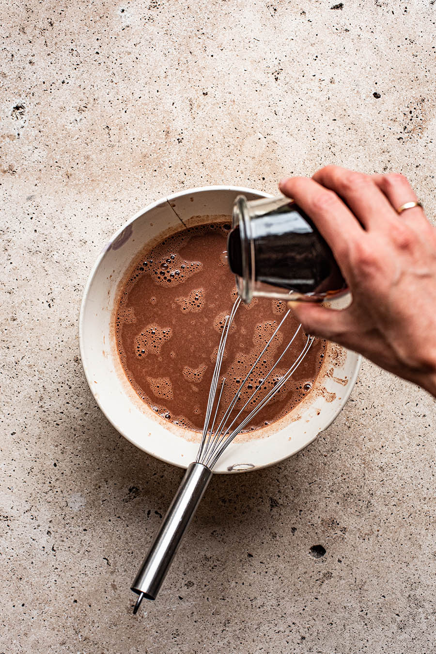 Adding date syrup to chocolate and coconut milk mixture.