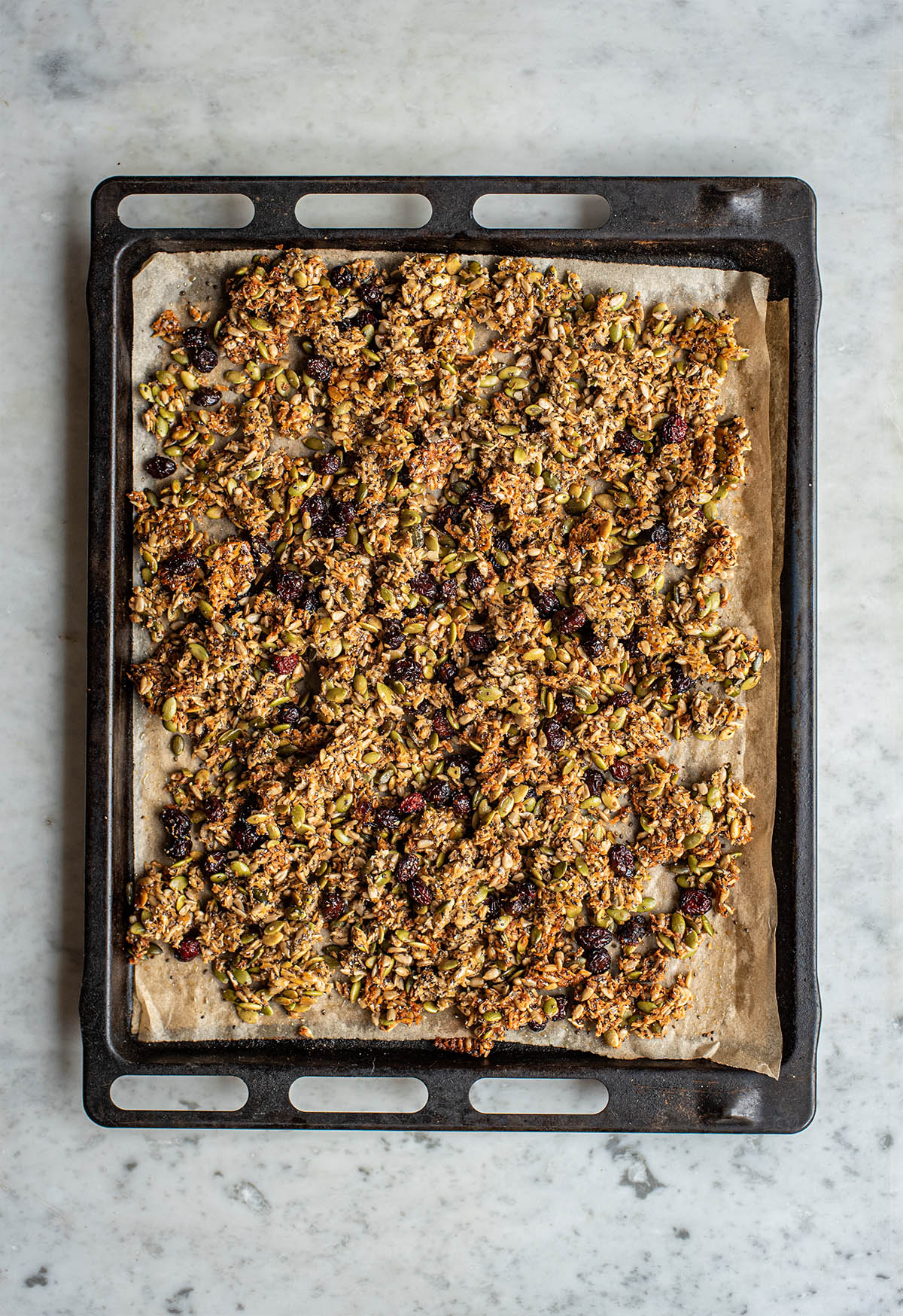 Granola on a large sheet pan, baked.
