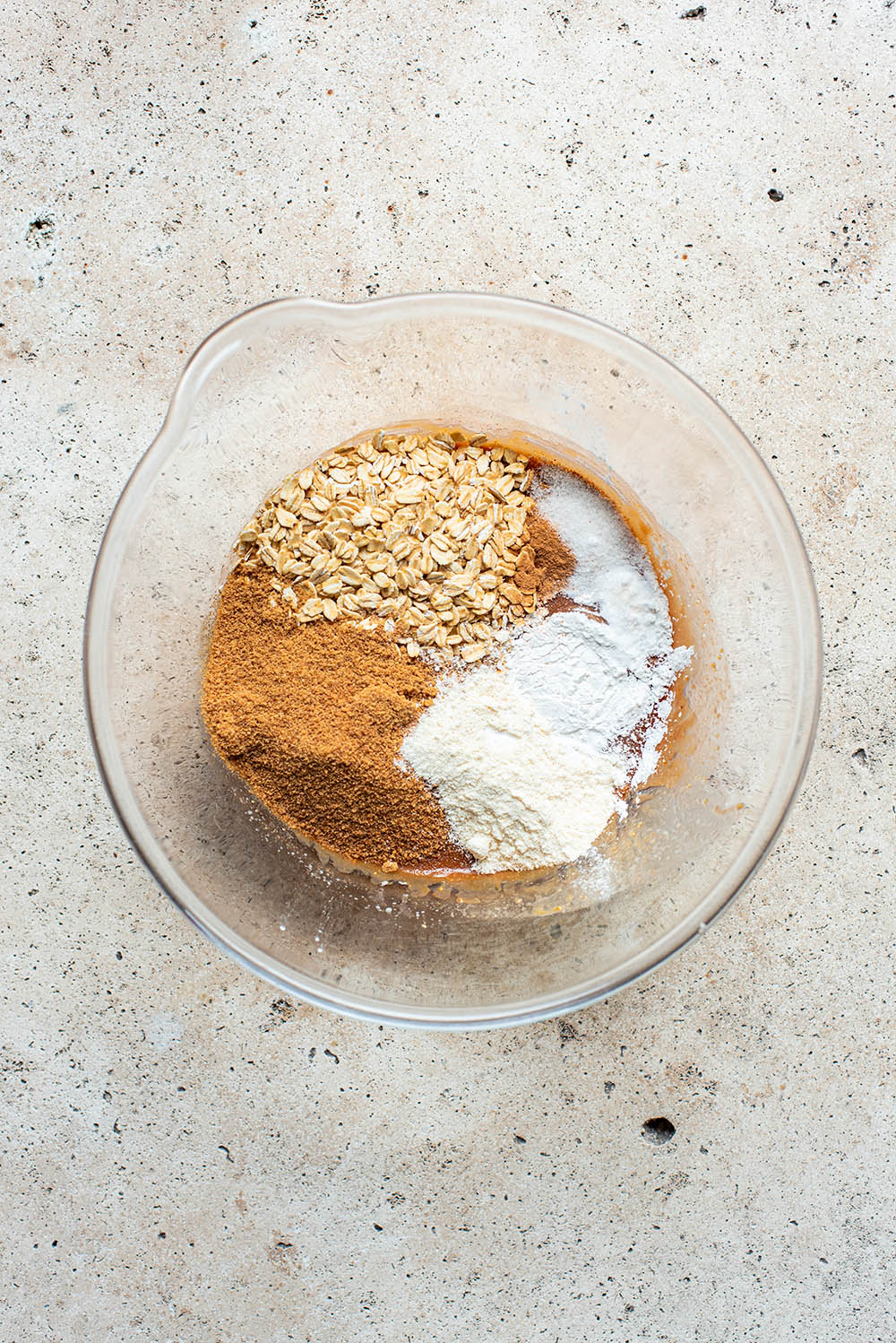 Coconut sugar, coconut flour, oats, and flavourings added to peanut butter mixture.