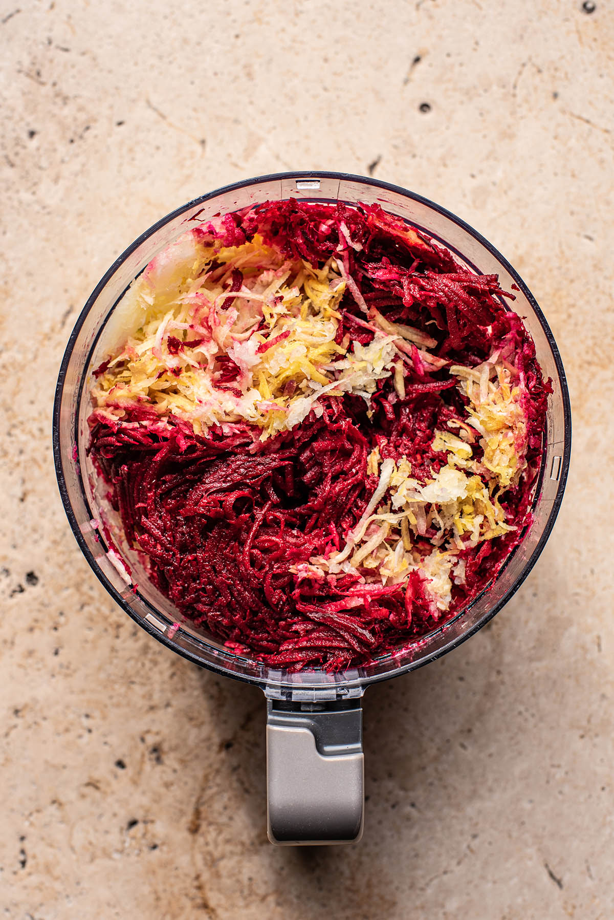 Shredded vegetables in a food processor.
