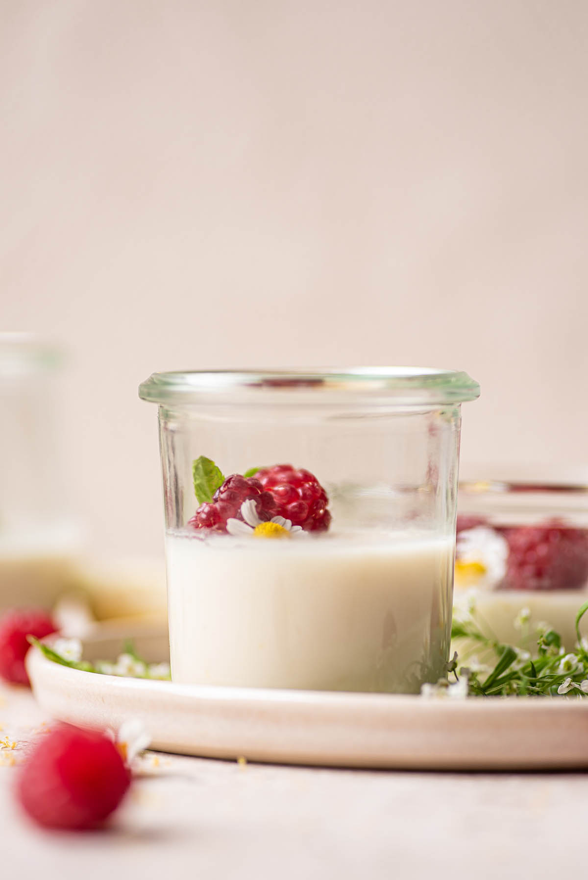 A small glass jar half filled with white pudding.