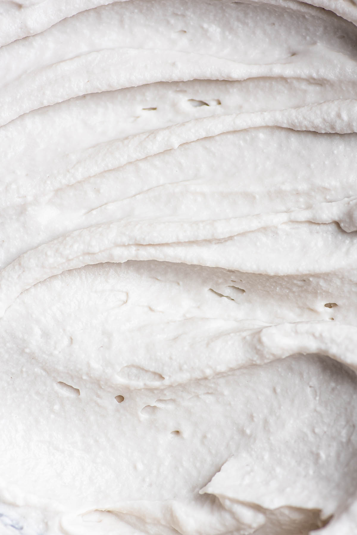 Close up of swirled coconut whipped cream.