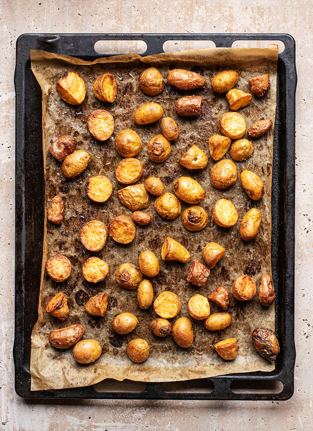 Potatoes on a baking sheet after roasting.