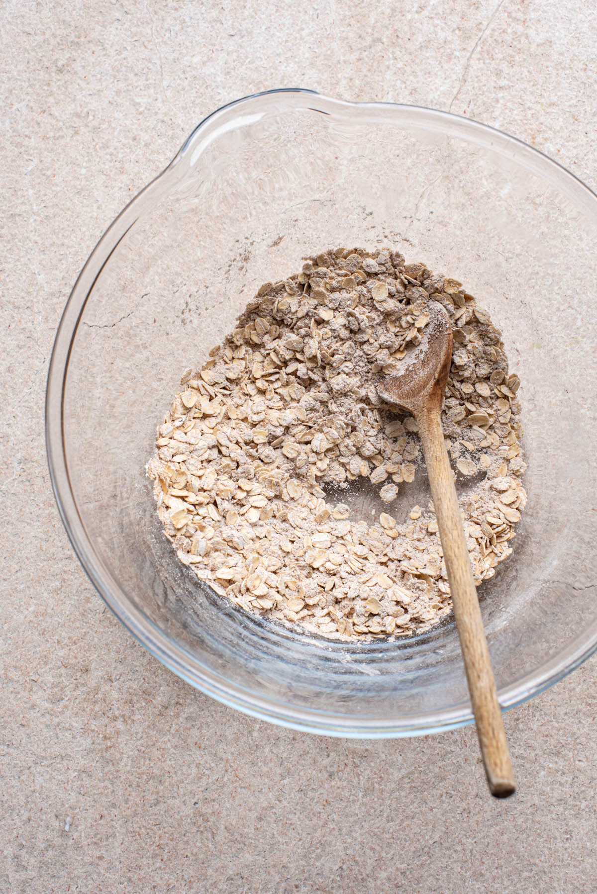 Oatmeal cookie dry mix in a large glass bowl.