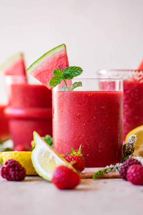 Close up of a pink smoothie in a glass.
