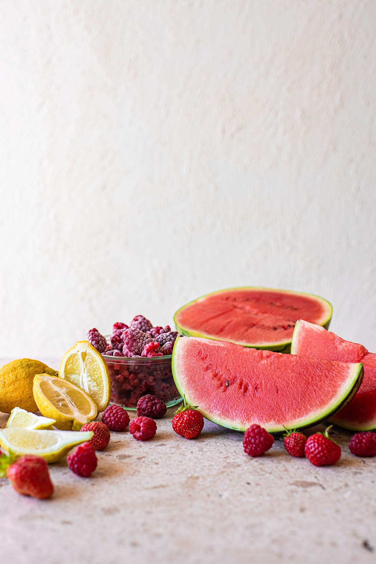 Watermelon smoothie ingredients: lemon, berries, watermelon.