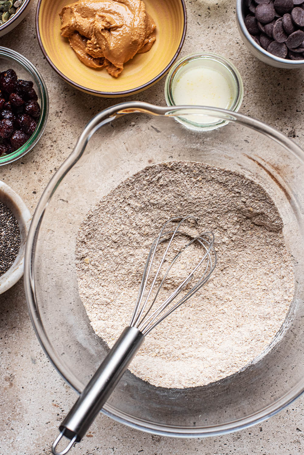 Dry cookie ingredients whisked together in a large bowl.