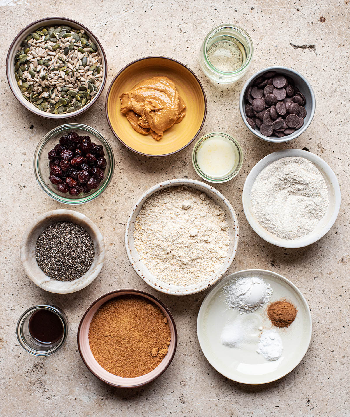 Trail mix cookie ingredients set up as a flat lay.