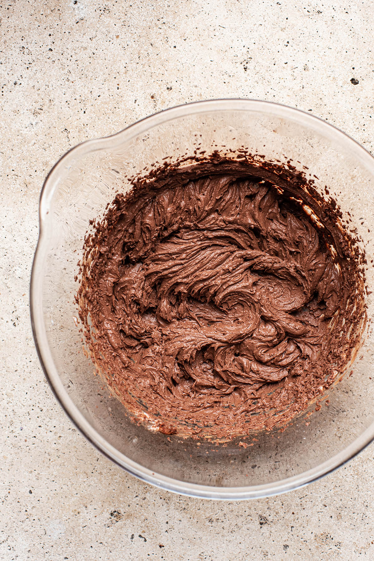Chocolate mousse whipped in a large glass bowl.