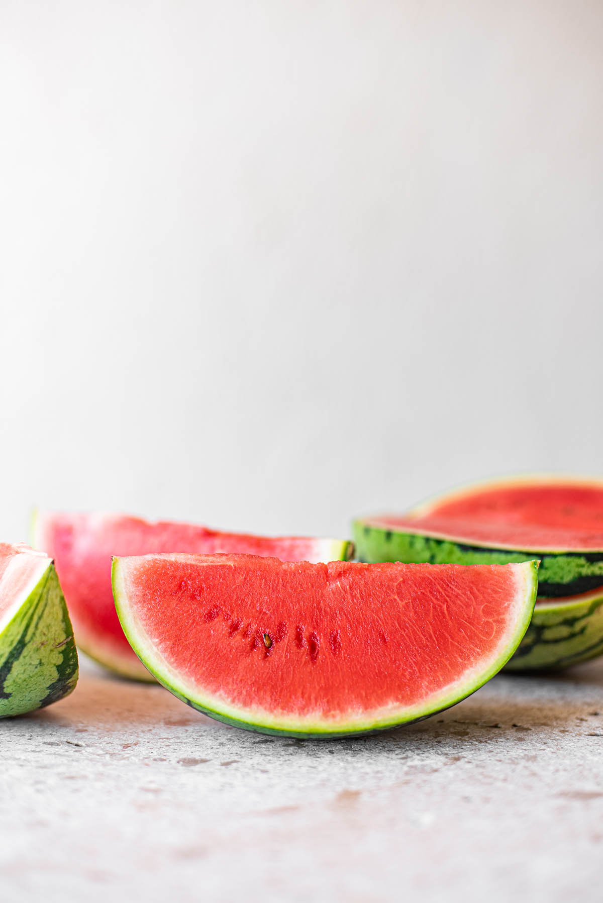 Wedges of watermelon arranged together.