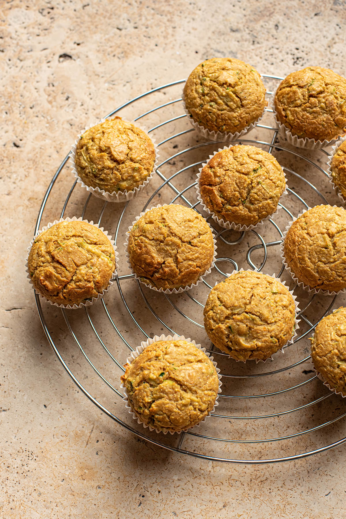 Cornbread muffins on a round cooling rack.