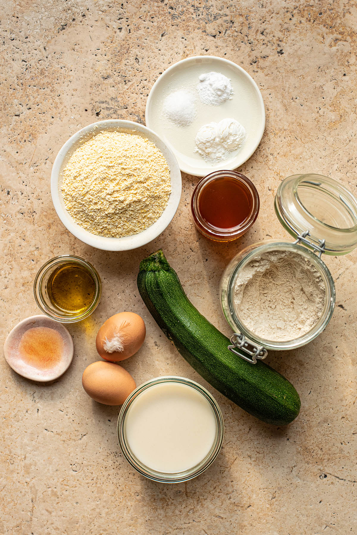 Dairy free zucchini cornbread muffin ingredients in a flay lay.