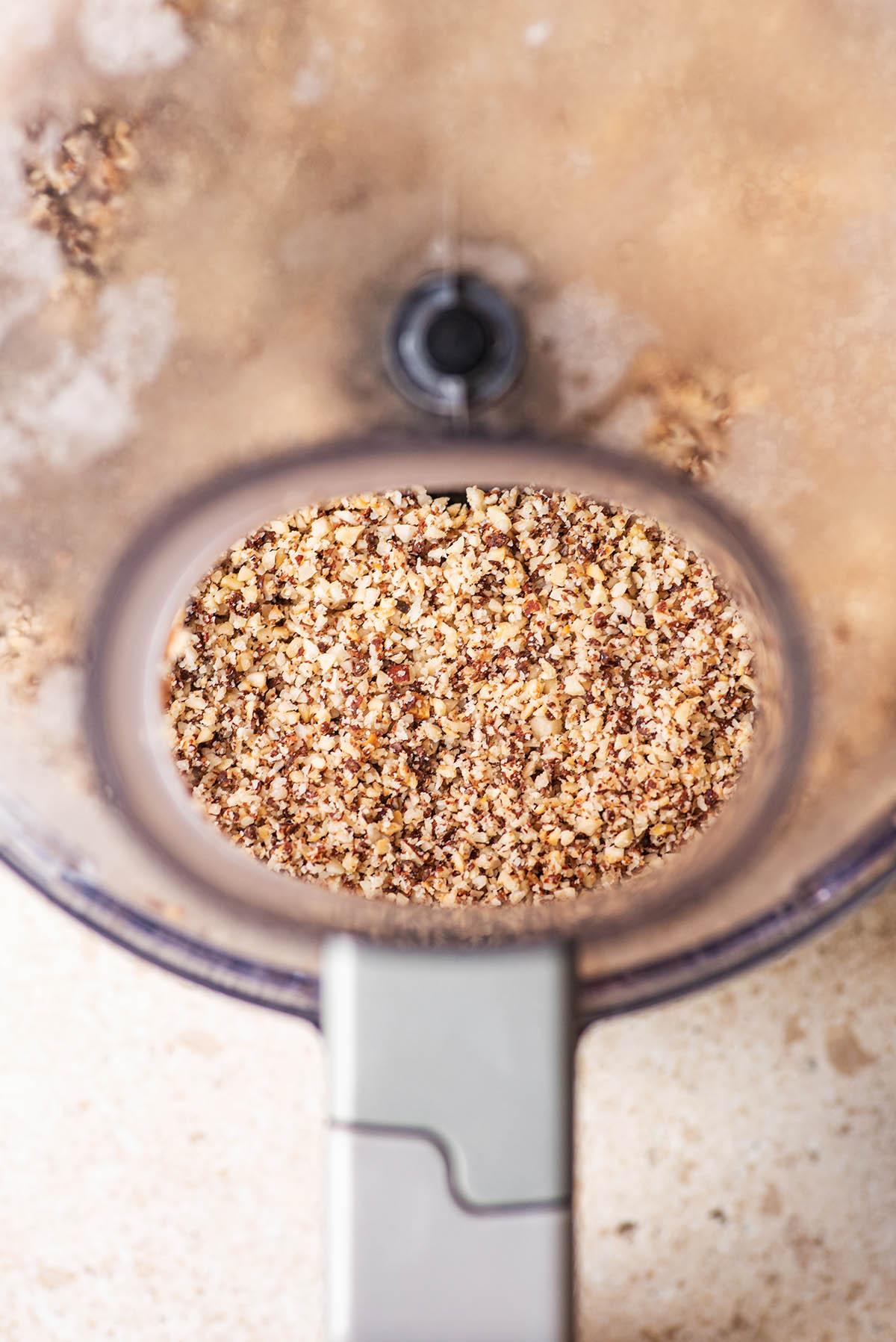 Hazelnut meal in a food processor.