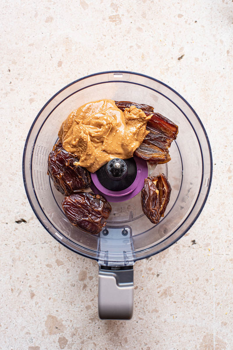 Peanut butter and dates in a food processor.