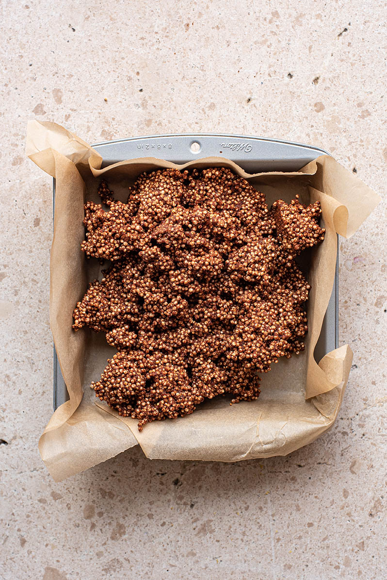 Quinoa bar mixture in a square tin.