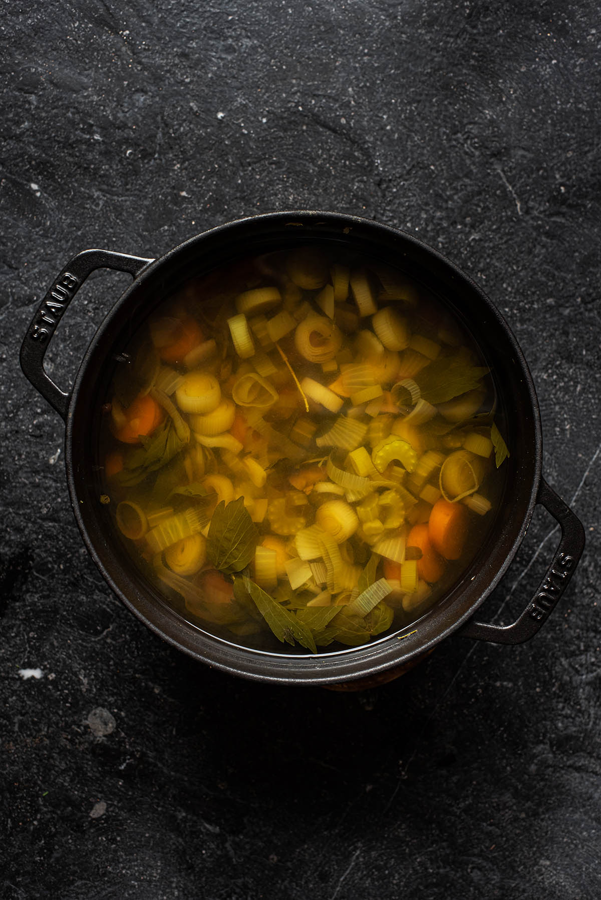 Vegetable broth in a large pot after cooking the vegetables.