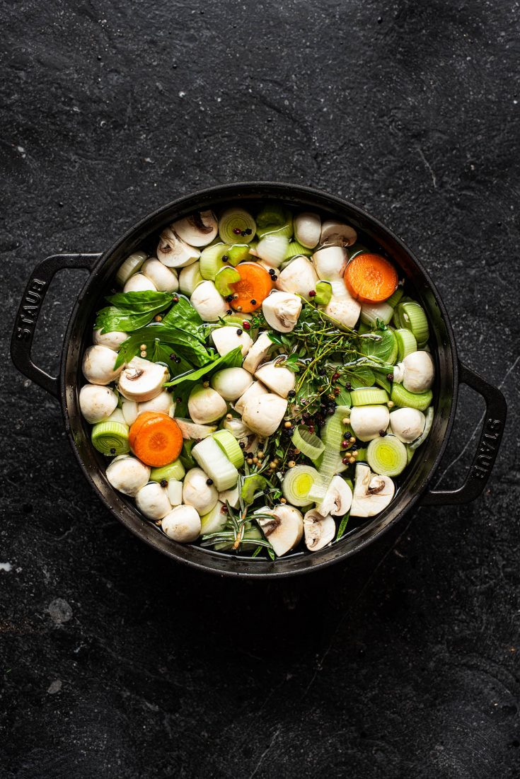 Vegetables and water in a pot before cooking.