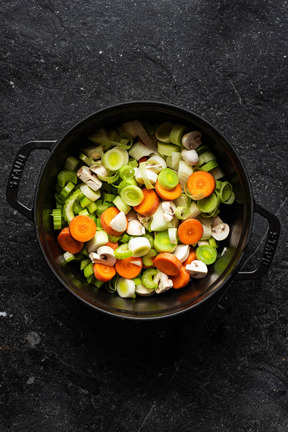 Cut vegetables in a large stock pot.