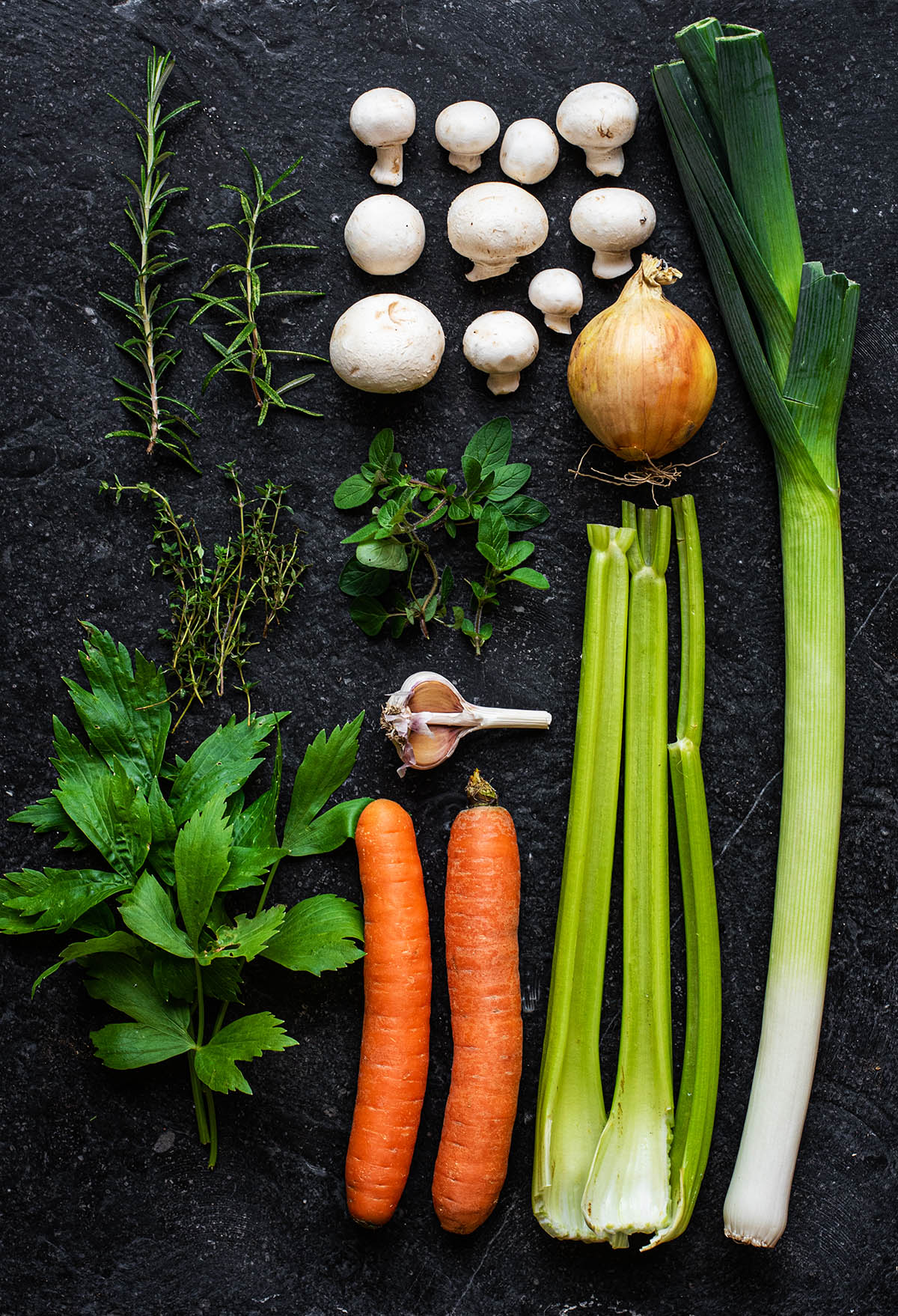 Vegetables for broth arranged in a grid.