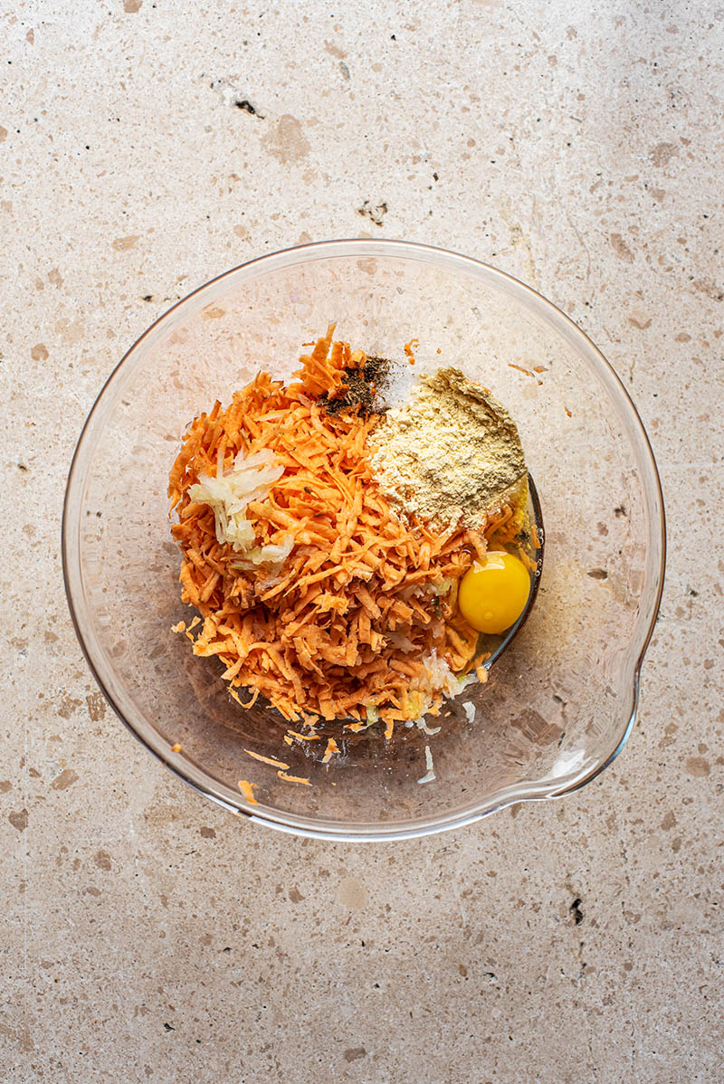 Latke ingredients in a large bowl before mixing.